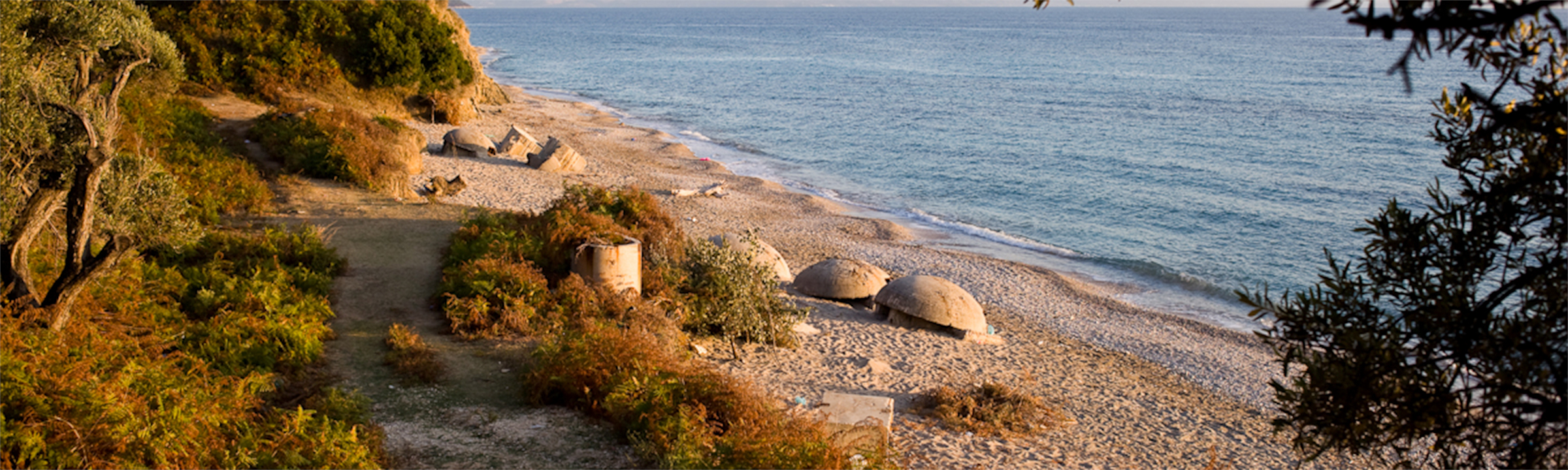 Beautiful sunset with a bunker on a Southern Albania Ionian beach